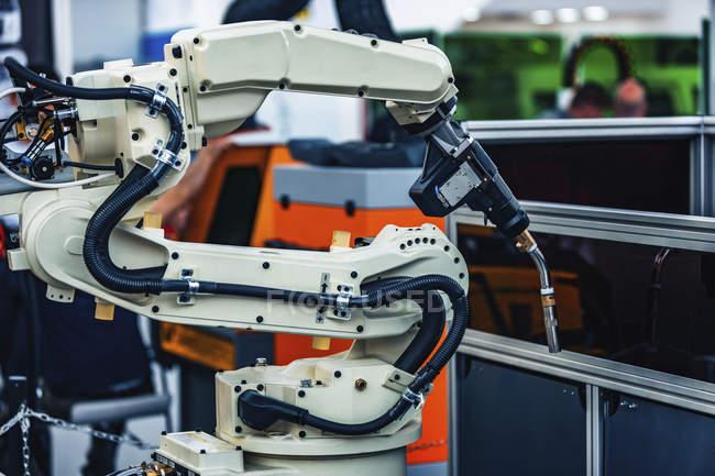 Arc welding wrist robot in modern industrial facility. — стокове фото