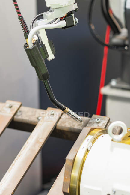 Automated welding machine in modern industrial facility. — Stock Photo
