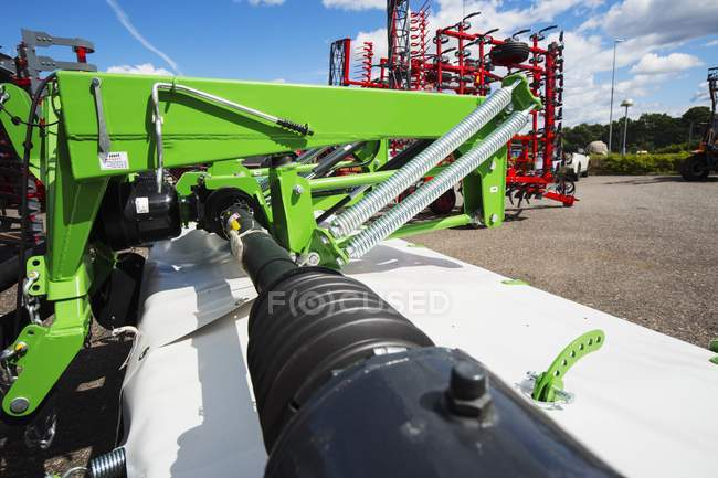 Hydraulic system on industrial mower coupled to tractor. — Stock Photo
