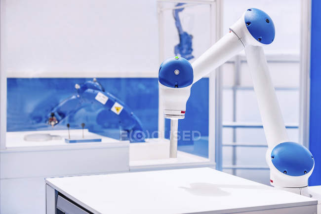 Collaborative robotic arm in modern industrial facility. — Stock Photo