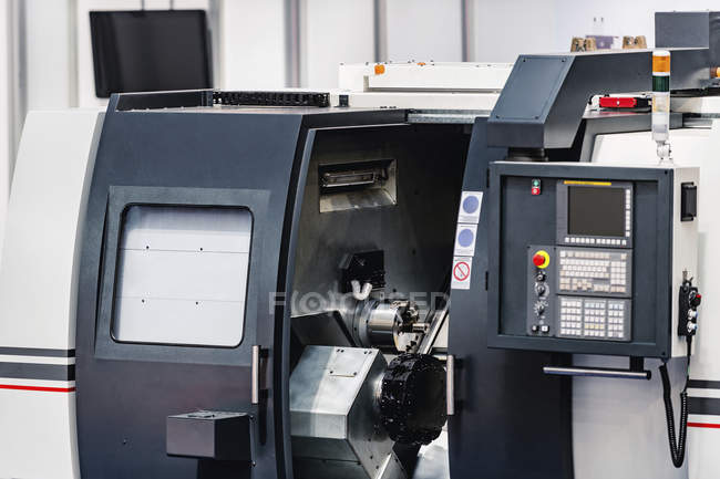 CNC machine in modern industrial facility. — стокове фото