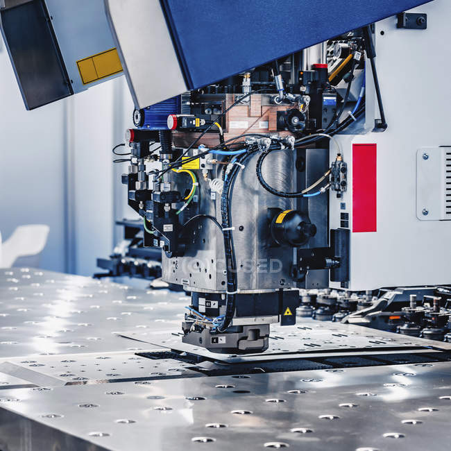 Industrial metal working machine in modern industrial facility. — Stock Photo