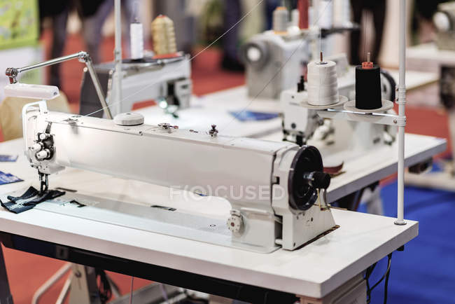 Industrial sewing machine in modern production facility. — Stock Photo