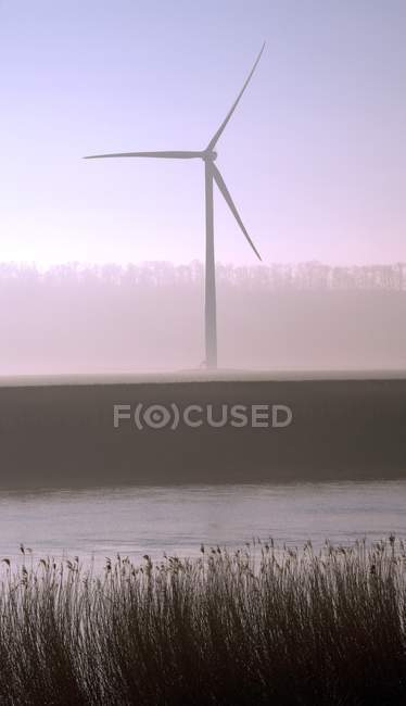 Wind turbine in fog by river Trent, England, UK. — Stock Photo
