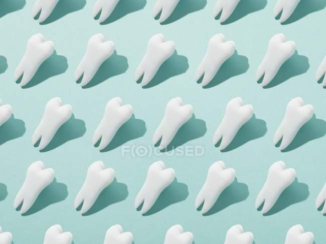 Human teeth pattern on blue background. — Stock Photo
