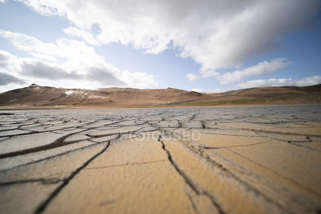 Dry cracked soil under cloudy sky, LAlbufera de Valencia, Spain. — Stock Photo