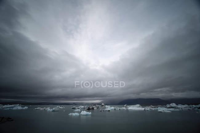 Sea ice floating off coast  under cloudy sky of Iceland, Europe. — Stock Photo