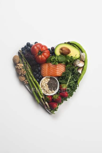 Healthy food in heart shape, heart health concept. — Stock Photo