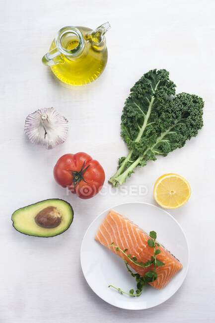 Mediterranean diet healthy vegetables, fruits, olive oil and fatty salmon fish. — Stock Photo