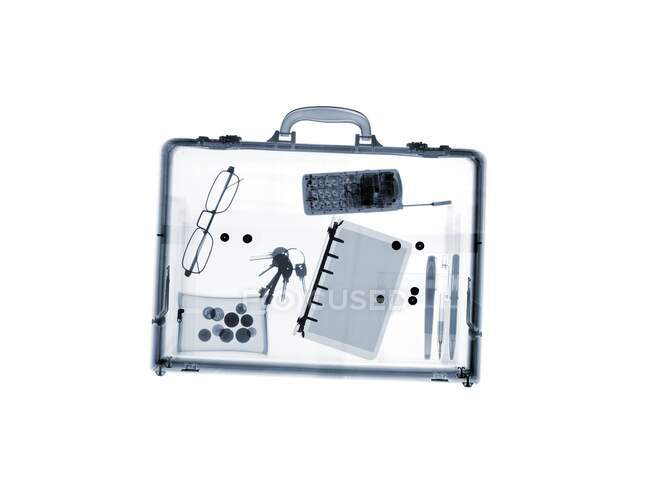 Briefcase with various items, X-ray. — стокове фото