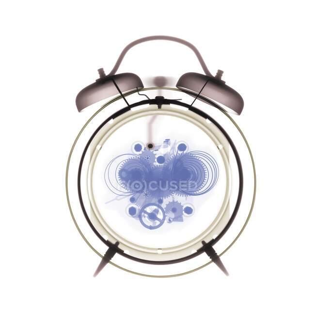 Тривожний годинник, кольорове рентгенівське проміння.. — стокове фото