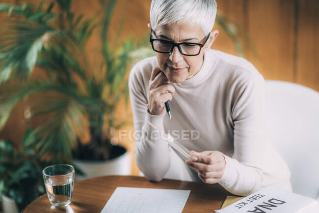 Genetic Test. Tube and swab for DNA collection from mouth. — Stock Photo