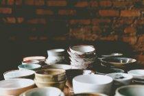 Empty colorful ceramic bowls — Stock Photo