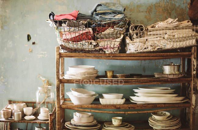 Tableware on wooden shelves — Stock Photo