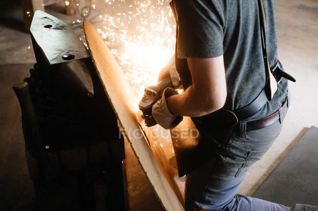 Artisan welding in workshop — Stock Photo