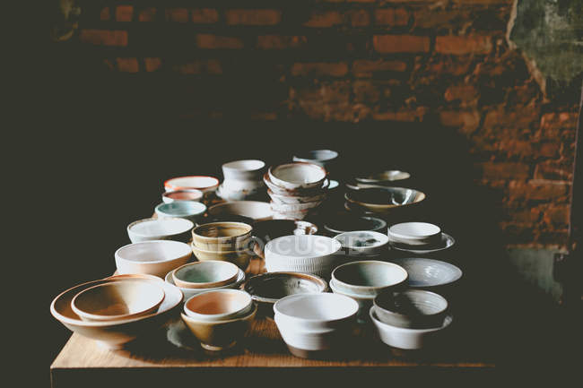 Empty colorful ceramic bowls — Stock Photo