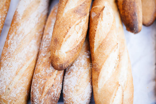 Fresh baguettes at bakery — Stock Photo
