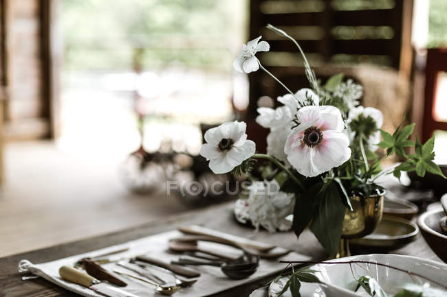 Fresh cut flowers on table — Stock Photo