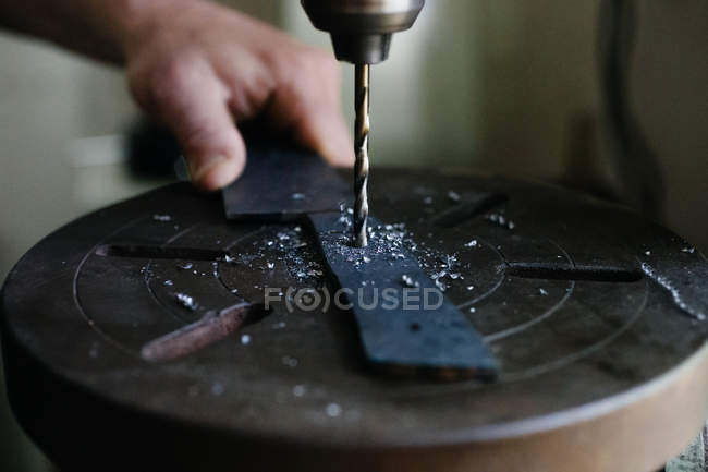Artisan working with drill in workshop — Stock Photo