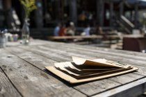 Menu on wooden table — Stock Photo