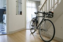 Bicycle placed near staircase — Stock Photo