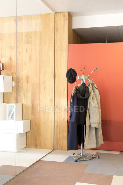 Glass wall and clothes hanger — Stock Photo