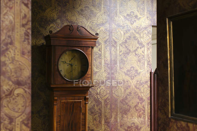 Classical clock in corner — Stock Photo