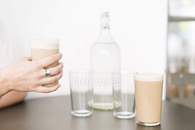 Female hands holding cafe latte — Stock Photo