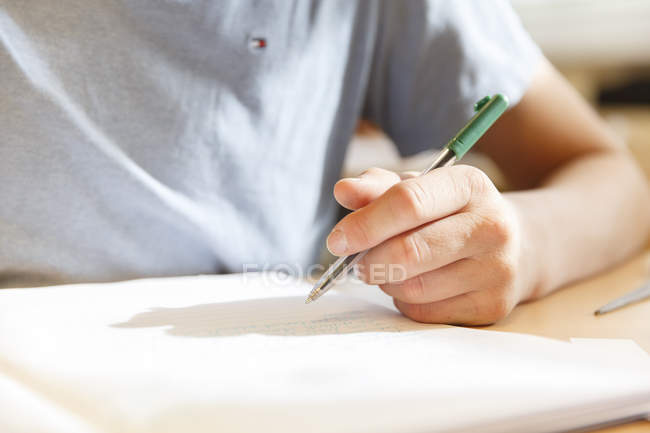Boy holding pen — Stock Photo