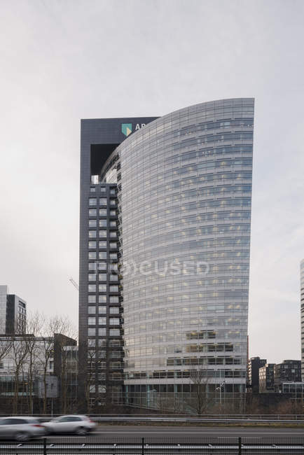 AMSTERDAM, NETHERLANDS - FEBRUARY 9, 2018: Highway and contemporary buildings in Zuidas business district — Stock Photo