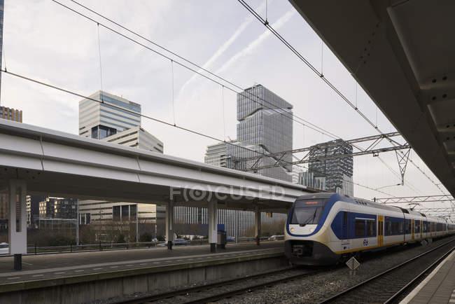 AMSTERDAM, NETHERLANDS - FEBRUARY 9, 2018: Train at railway station platform in Zuidas business district — Stock Photo