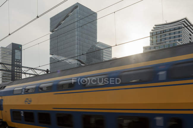 AMSTERDAM, NETHERLANDS - FEBRUARY 9, 2018: Train passing in Zuidas business district of city — Stock Photo