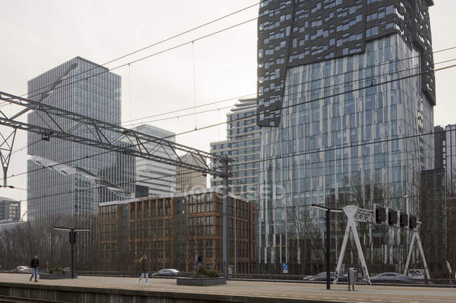 AMSTERDAM, NETHERLANDS - FEBRUARY 9, 2018: Contemporary buildings in Zuidas business district of city — Stock Photo