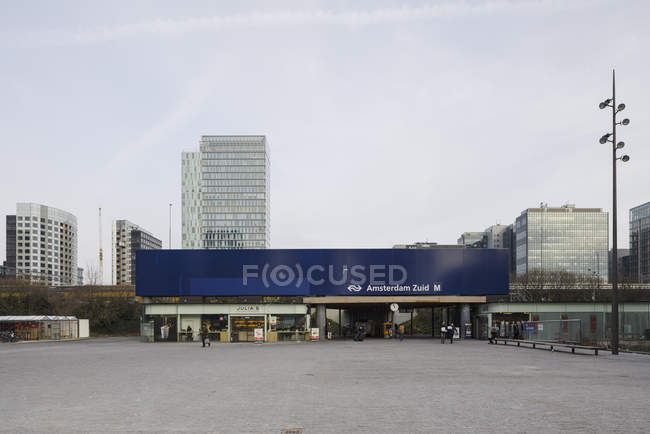AMSTERDAM, NETHERLANDS - FEBRUARY 9, 2018: Train station in Zuidas business district of city — Stock Photo