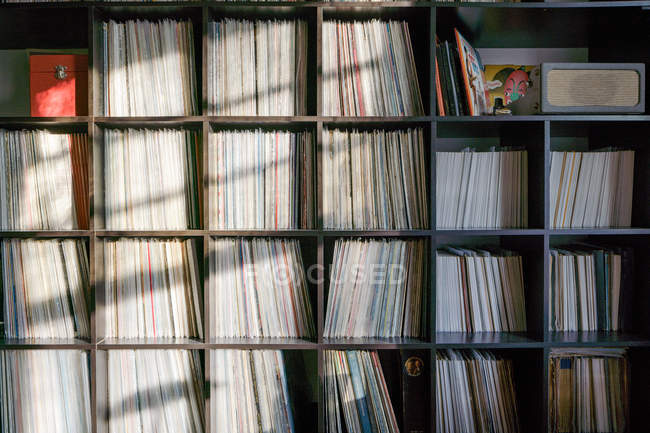 Old fashioned vinyl records in cupboard. — Stock Photo