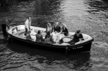 Amsterdam, Holland - June 18, 2016: It's saturday and the dutch youth make a party along the Amsterdam canals. — Stock Photo