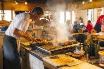 Barbecue for tourists in Scotoni hut — Stock Photo