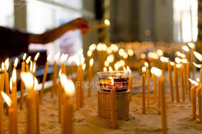 Man Lighting candles — Stock Photo