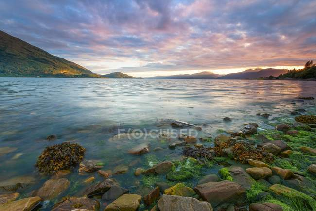 Rocky lake shore at Loch Leven — Stock Photo