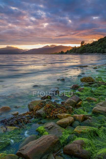 Rocky lake shore at Loch Leven — Stock Photo