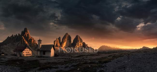 Remote resort among Alps at sunset — Stock Photo