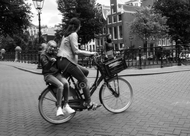 Amsterdam, Netherlands - June 18, 2016: mother and child ridding on bike — Stock Photo