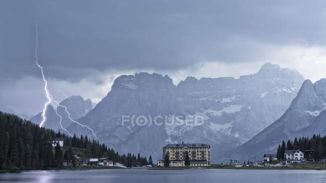 Thunderbolt over Misurina Lake, in background Sorapis mountains, Dolomites, Italy — Stock Photo
