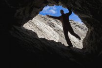 Man posing in cave — Stock Photo