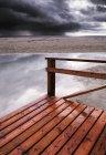 Wooden Boardwalk Leading To Water — Stock Photo