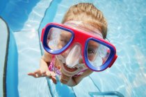 Little cute girl in swimming googles, high angle — Stock Photo