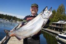 Man Holding Large Fish — Stock Photo