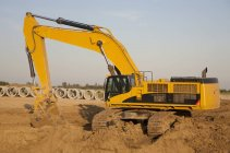 Backhoe Digging For Sewer Installation — Stock Photo