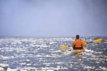 Rear View Of Man Kayaking Near Snoqualmie Falls, Washington, USA — Stock Photo