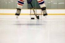 Cropped Image Of Hockey Player With Stick And Puck On The Ice — Stock Photo